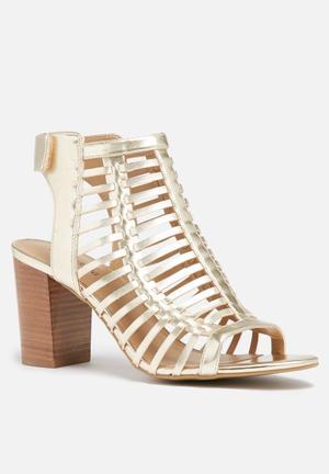 Call It Spring Miriradia Boots Gold