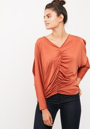 Ruched front cold shoulder knit top