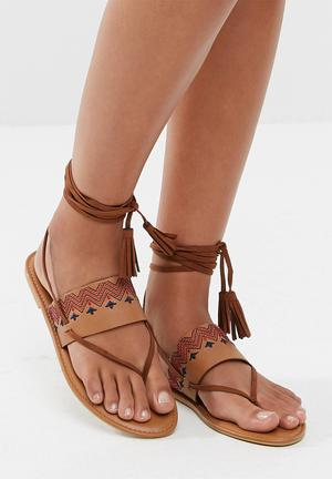 Zoom Nikki Sandals & Flip Flops Tan