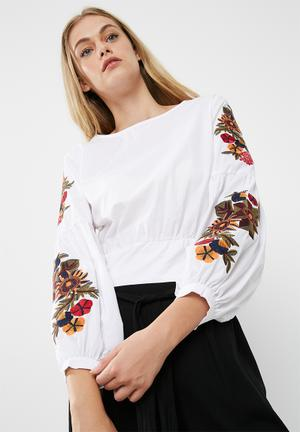 Embroidered blouse with bow back