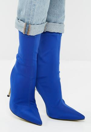 Staple patent stiletto heel boot