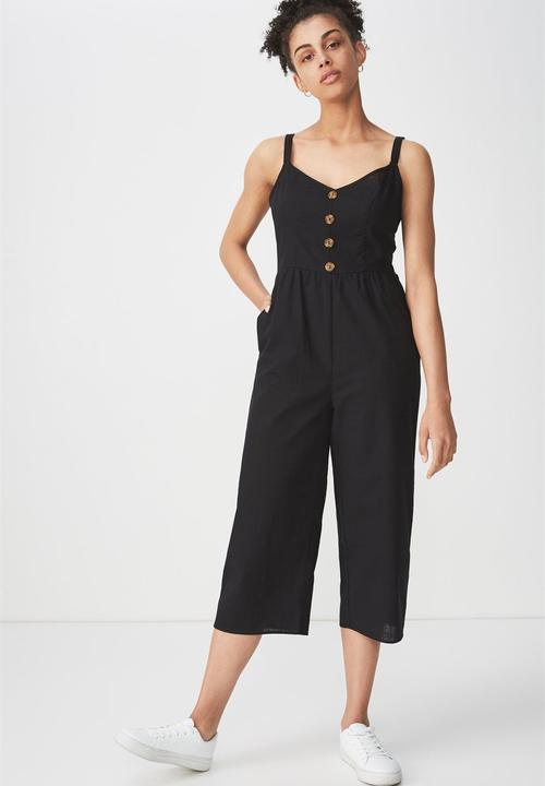 c64a19f8d1d Woven toni strappy jumpsuit - black Cotton On Jumpsuits   Playsuits ...