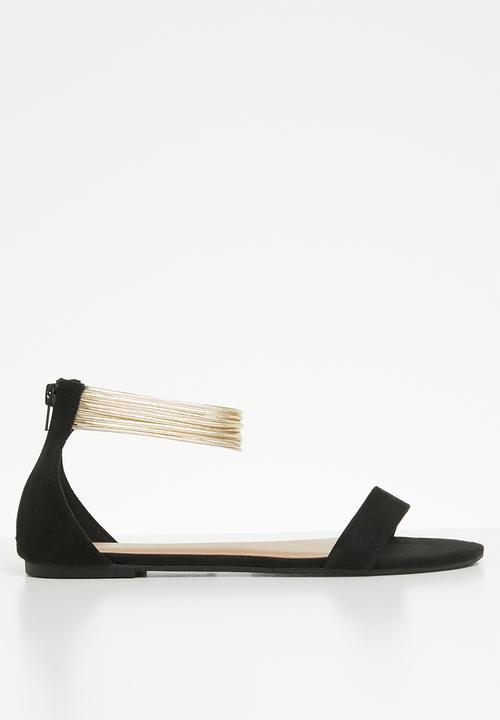 ebf08bc9e30 Salvin faux suede metallic ankle strap flat sandal - black Call It ...