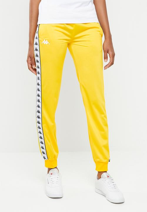 c698638c74 Banda slim fit track pants - yellow & black KAPPA Bottoms ...