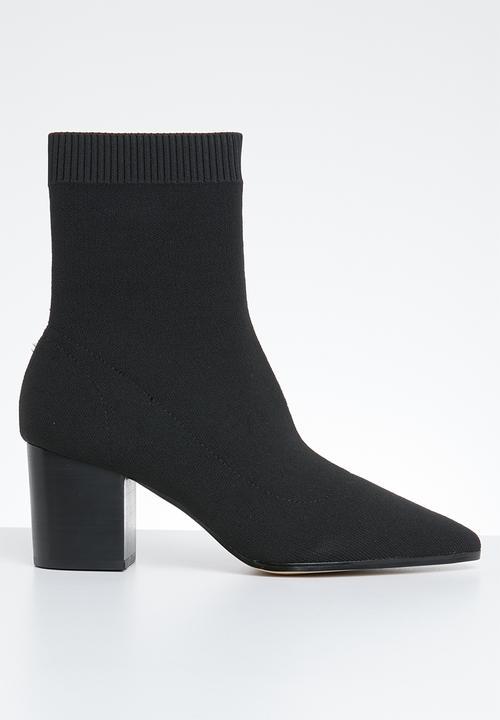 cb8f203c09d9 Gwaunia pointed block heel ankle sock boot - black ALDO Boots ...