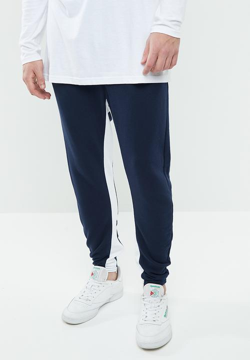 a3a38aee71e CL F Zip Jogger - Collegiate Navy Reebok Classic Sweatpants & Shorts ...