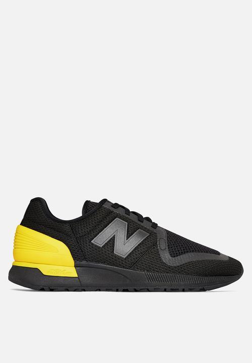 black/yellow New Balance Sneakers
