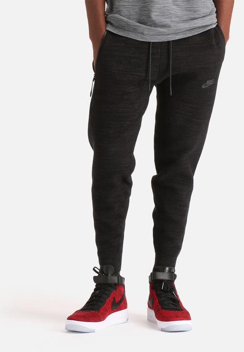 TECH KNIT LIBERO PANT-BLACK ANTHRACITE Nike Sweatpants   Shorts ... b7bb445a0238