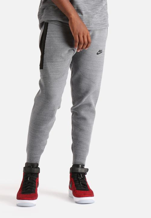 TECH KNIT LIBERO PANT-ANTHRACITE WOLF GREY Nike Sweatpants   Shorts ... 9091cc8d1ada