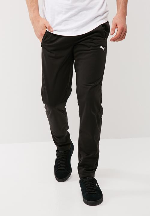 c7feb9e1c8da Tricot Slim Leg Pants - Black PUMA Sweatpants   Shorts