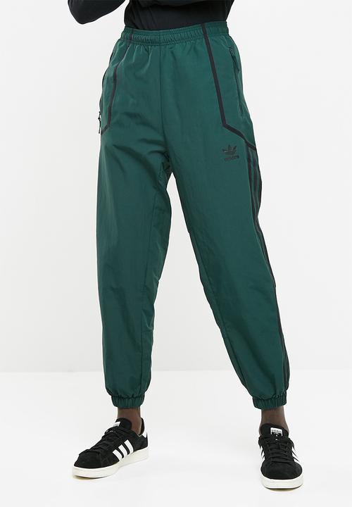 b4208834d Taped wind pant - green adidas Originals Sweatpants & Shorts ...