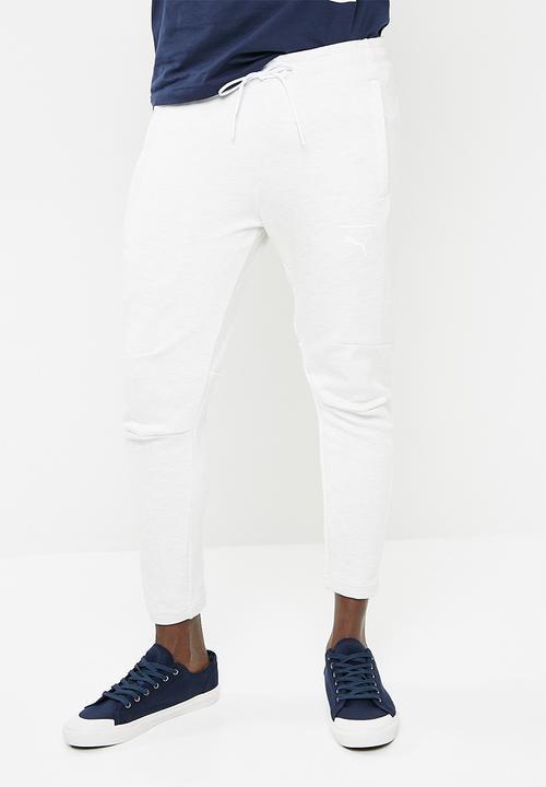 81f7b933c5f2 Pace primary pants - white PUMA Sweatpants   Shorts
