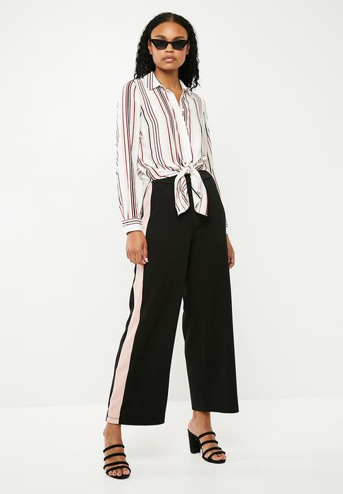 10f58357249d3 Textured wide leg knit pant - Black with soft pink side stripe ...