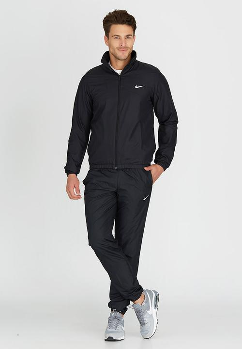 b1ddf22686d0 Nike Half Time Woven Tracksuit Black and White Nike T-Shirts ...