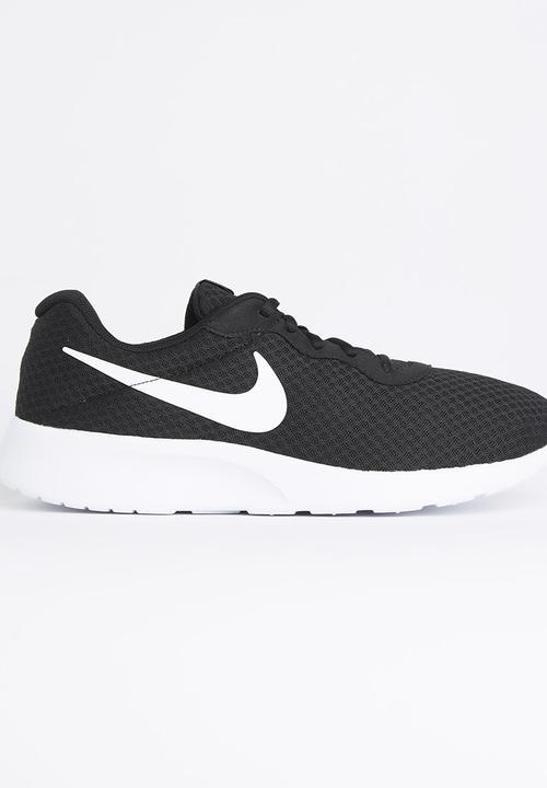 Nike - Nike Tanjun Sneaker Black and White. ON SALE 642ae42c2