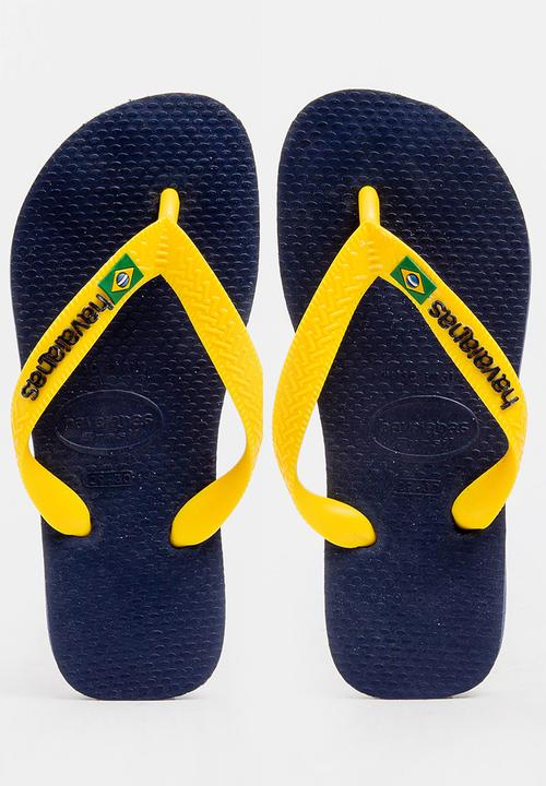 ac68de6ab968b2 Brazil logo flip flops - navy blue citrus yellow Havaianas Shoes ...