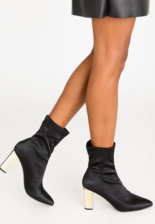 99f4c0bbf4087 Munich Block Heeled Sock Ankle Boots Black Dolce Vita Boots ...