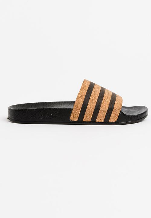 97b9b10c6 Adilette Slides Black adidas Originals Sandals   Flip Flops ...