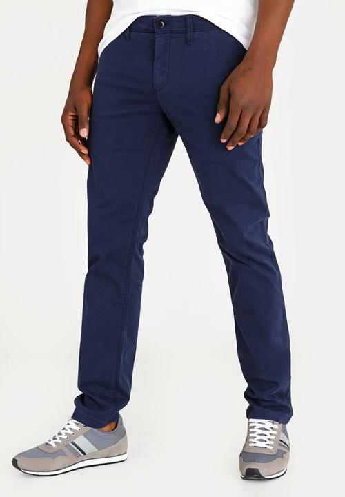 0f18e7f2ad6 Basic Slim Chino Pants Blue Tommy Hilfiger Pants & Chinos ...