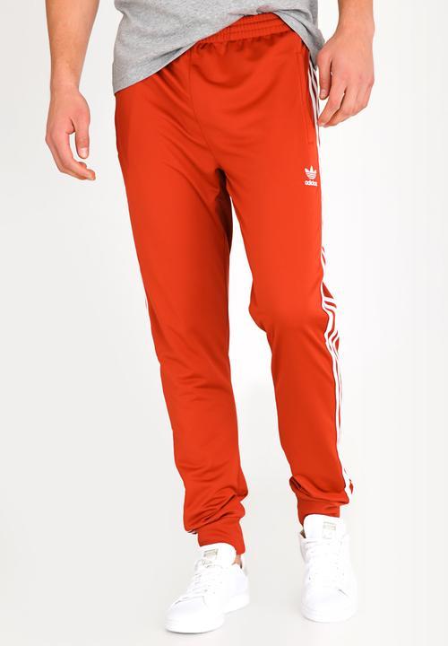 71333401d40 SST Track pant - shift orange/white adidas Originals Sweatpants ...