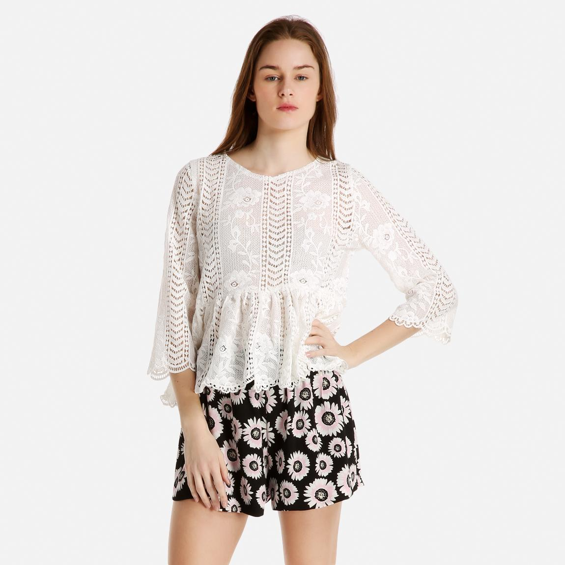 Woven fabric Broderie detail Round neck with tie detail and tassel ends Three quarter puff sleeve Peplum hem Our model wears a UK 8 and is cm/5'9'' tall.